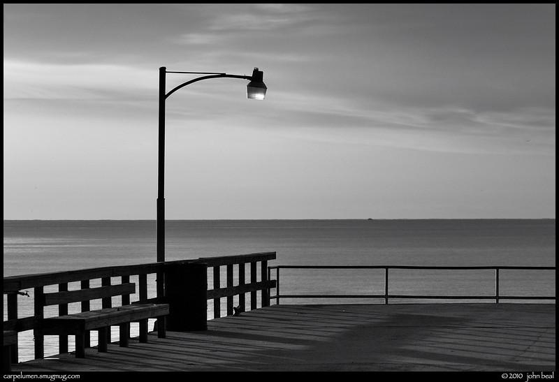 monochrome: pier at sunise, st simons island, georgia.