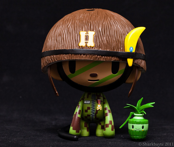 """March 29, 2011- As we leave our friends Cheburashka and Gena to settle in and get used to living together, we go back to the jungle and meet Captain Coco. """"Captain Coco was once a simple and carefree monkey, living in a lush tropical paradise among his jungle friends. One day, smoke and noise woke Coco from a lazy afternoon nap; his jungle home was being invaded by evil developers! Captain Coco knew what he had to do. He alerted his pals and together they formed the Cocommando. The Cocommando patrols the jungle, teaching everyone to appreciate the wonder of nature as a unique and precious treasure, while protecting the beauty of the land."""" -from Simone Legno (Tokidoki) Day 89:365 @sharkbayte<br /> <br /> thank you for all the comments and suggestions, much appreciated."""