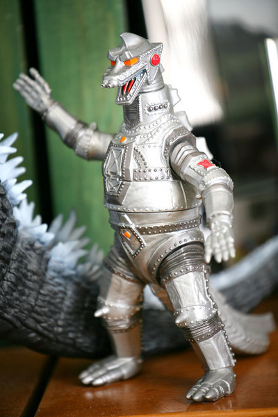 2/7/11. Even my mascot, Mechagodzilla, is sick of the snow. He didn't even stop a rock from smashing the MINIs windscreen.