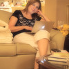 6/8/11: Mary Facebooking i living room. Shot with Olympus E-PL2 with Soft Focus Art Filter.
