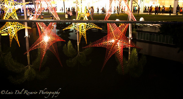 Christmas lights at Fort Bonifacio High Street at Market Market, Philippines. I thought the reflection was very nice on a still water.