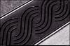 """(20Apr11)  ornamental sidewalk drain.  <a href=""""http://carpelumen.smugmug.com/Photography/2010/April10/11696745_oPfad/1/842596094_MRVsH/Medium"""">one year ago.</a>  f/11, 1/100s, iso 200."""