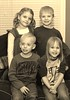 """December 30 2011 My legacy<br /> <br /> Jill bought an antique frame and wanted a picture of the four grandkids in sepia with a vertical format.  This is what I came up with Wednesday. It's not easy to tear four kids away from new Christmas toys to pose for a picture. :-)<br /> <br /> The modern clothing doesn't exactly fit with sepia but what the heck.<br /> <br /> Update: As I started to comment I found that the #1 picture is Judy's cardinal from a year ago.  One person must have run across it and then 4 more people piled on.  I wish people would not do this.  To me it takes away from the """"daily"""" theme.  Not that it isn't a wonderful picture but it had it's moment of fame a year ago.  I know there aren't any rules here and I'm not proposing any - just wish that people would stick to commenting and rating more recent stuff."""