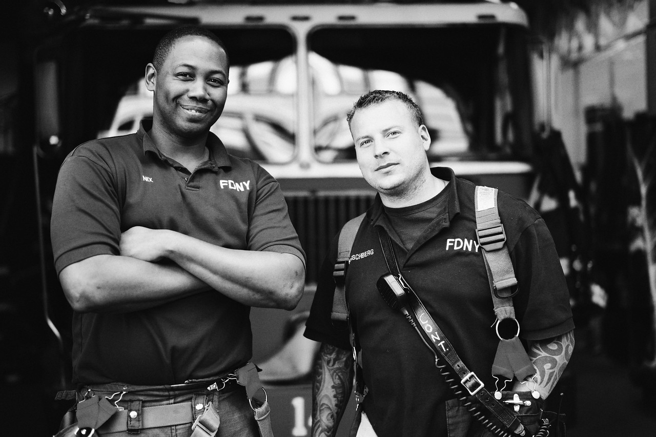 2 New York City firefighters pose for a quick shot as I walked by the station.