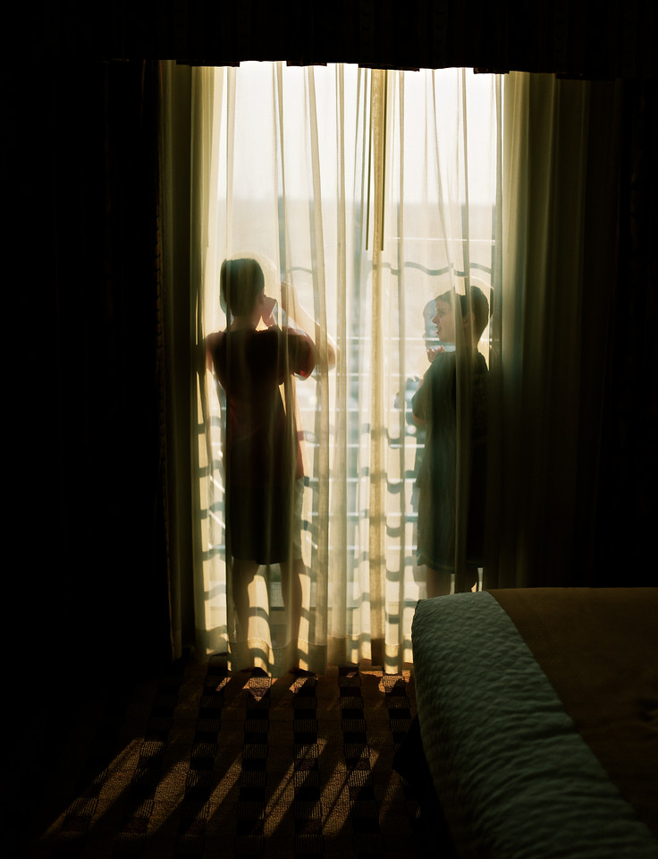 Micah and Ethan looking out the hotel window in Minneapolis.