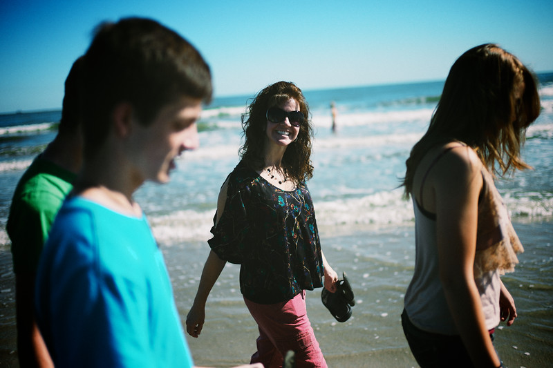 My sweet wife flashes a smile as we walk along the beach with the kids.