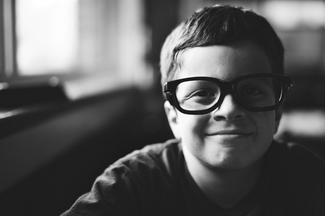 Our youngest dude Ethan wearing huge fake glasses to Chili's just because he thought they were funny. <br /> Huge imagination and loves to laugh. What a character. :)