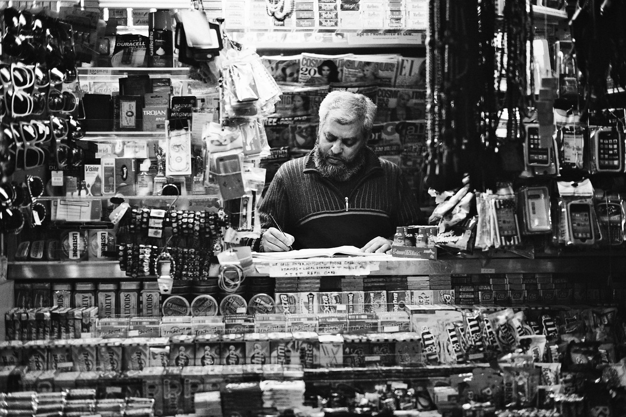 Quiet day at the office...<br /> A New York street vendor passes the time while waiting for customers.