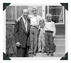 June 17 2012 In memory of my Dad<br /> <br /> My Dad and his three sons in 1955 standing on the steps of the first house he ever owned. I lived there for 8 years.  I lost my Dad in 1984 and I still miss him.  We were pretty close.<br /> <br /> (I used picmonkey's photo corners)<br /> <br /> Update: I'm the oldest with my arm around my Dad.