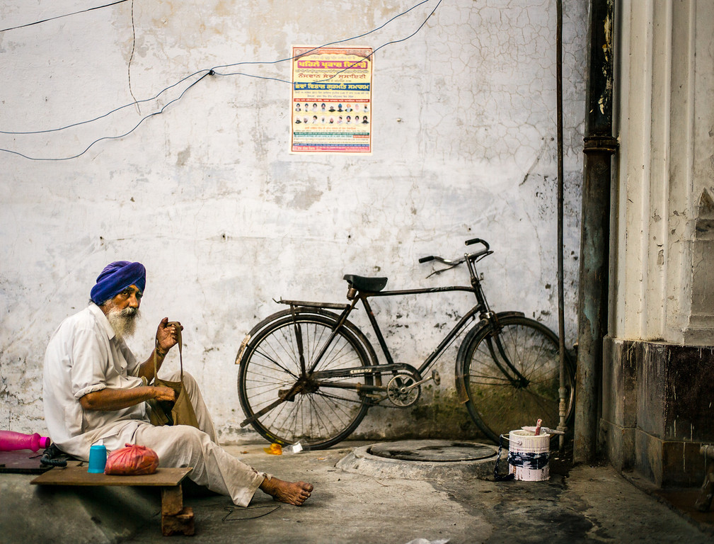A Sikh man and his bike outside Harmandir Sahib in Amritsar.