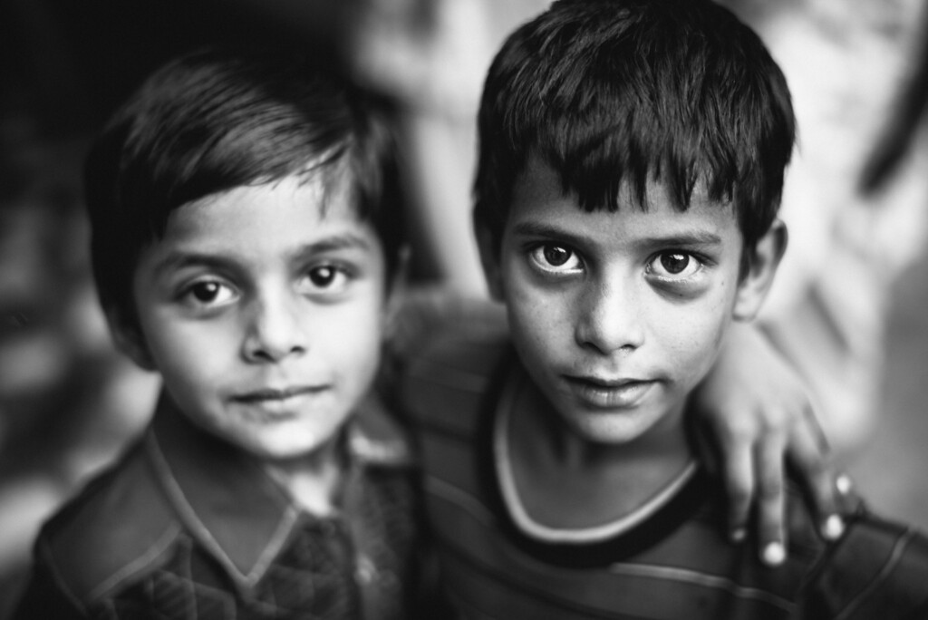Two young boys playing in a village in Punjab, India.