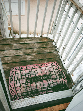 Turn welcome mat around: Get welcomed to the world when you leave for the day.