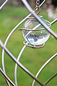 4 Jan 13 – Glass ornament in garden, hanging from cherry.  I'm working on improving my focus . . .