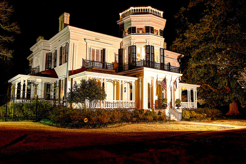 """White Arches at night. Affectionately called """"Columbus Eclectic,"""" the combined architectural elements of Greek Revival, Gothic and Italianate come together to form a most welcoming style. Beautiful woodwork, mirrored glass doorknobs, a three story cupola and even original bedroom closets add to its allure. Mr. & Mrs. Dick Leike / National Register"""