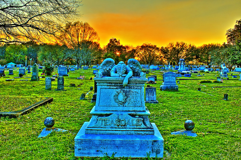 Teasdale Monument Sunset Canon HDR.Weeping Angel Friendship Cemetery Columbus Mississippi. Once a month the sun rise and sun set are in line with each other and this Sunday the weather cooperated with beautiful clouds.