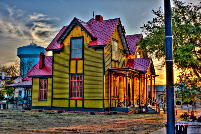 Welcome center Columbus Mississippi. Yes it was painted those colors not HDR grudge. Pulitzer Prize-winning playwright, Tennessee Williams first home. Tennessee Williams made history with well-known plays such as A Streetcar Named Desire, Cat on a Hot Tin Roof and The Glass Menagerie.