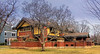 """March 26 2015 Beachy  House by Frank Lloyd Wright<br /> <br /> Another in Oak Park at 238 Forest Avenue.<br /> <br /> This impressive brick and stucco residence was erected for banker Peter A. Beachy, who commisioned Wright to """"remodel"""" the former gothic cottage that stood on this spot! The Beachy House is oriented at right angles to the street in order to utilize a part of the pre-existing foundation.  <br /> <br /> Southeast view from Forest Avenue  The open gables of the roofs resemble the gables of a number of reesidences built by Wright around the turn of the century. Many other details relate to other buildings by Wright in 1906; for example, the the square panes of glass supported by wooden mullions and the three part window of the ground floor tie the house firmly to its period of design.  <br /> <br /> The above commentary was excerpted from Guide to Frank Lloyd Wright & Prarire School Architecture in Oak Park by Paul E. Sprague (published 1986). <br /> <br /> I've been enhancing these with Topaz Clarity Landscape presets and graduated blue filter from Perfect Photo Suite."""