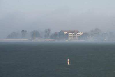 Frozen lake, fog, sunshine.