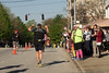 20 Mar 2016<br /> <br /> vernal equinox, palm sunday, atlanta marathon.<br /> <br /> downtown decatur is the halfway point. this shot is about 2.5 hrs into the run (i suppose the race portion is over about this same time for the elite runners). the saxophonist is play the theme from 'Rocky', and the runner is responding appropriately.<br /> <br /> f/7.1, 1/1000s, iso 200.