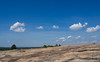 (5 Jun 2016)<br /> <br /> bradley peak, arabia mountain nature preserve, dekalb county, georgia.<br /> <br /> at the horizon on the left is panola mountain, another monadnock just to the south.<br /> <br /> f/11, 1/400s, iso 200.