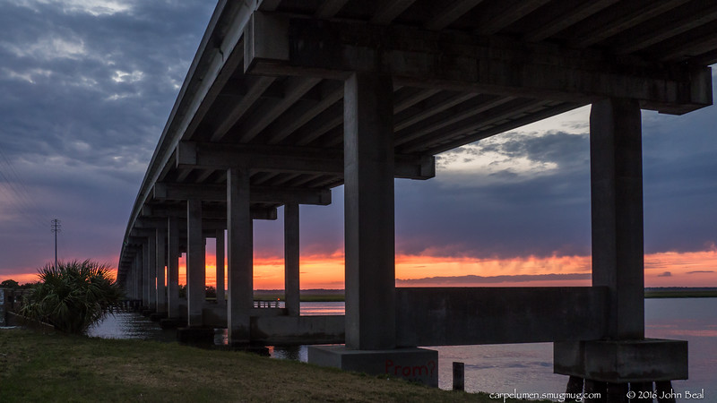 10 May 2016<br /> <br /> sunset beneath the mackay river bridge, torras causeway.<br /> <br /> f/5.6, 1/50s, iso 800.