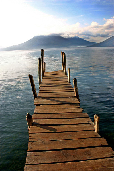 Boat dock on lake with volcano- Lake Atitlan, Guatemala