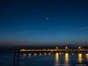 17 Feb 2018<br /> <br /> moonset (alternate) in color, village pier, st simons island, georgia.<br /> <br /> f/11, 5s, iso 400.