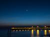 17 Feb 2018<br /> <br /> moonset (alternate) in color, village pier, st simons island, georgia.<br /> <br /> f/11, 5s, iso 400.