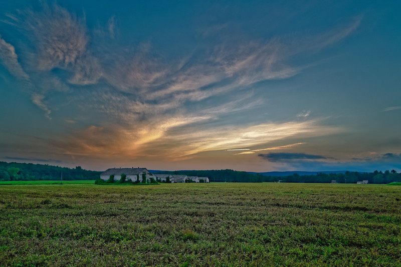 Sunset over Old Tobacco Drying Barns and Fields