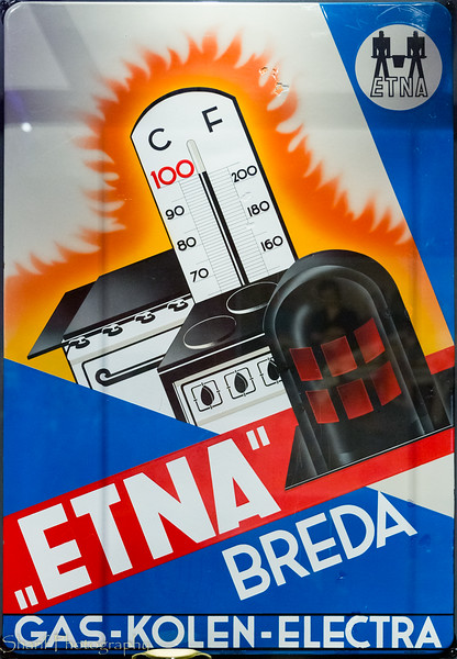 Advertising plaque for a dutch fireplace and oven company. Gas, coal or electric, they do it all.
