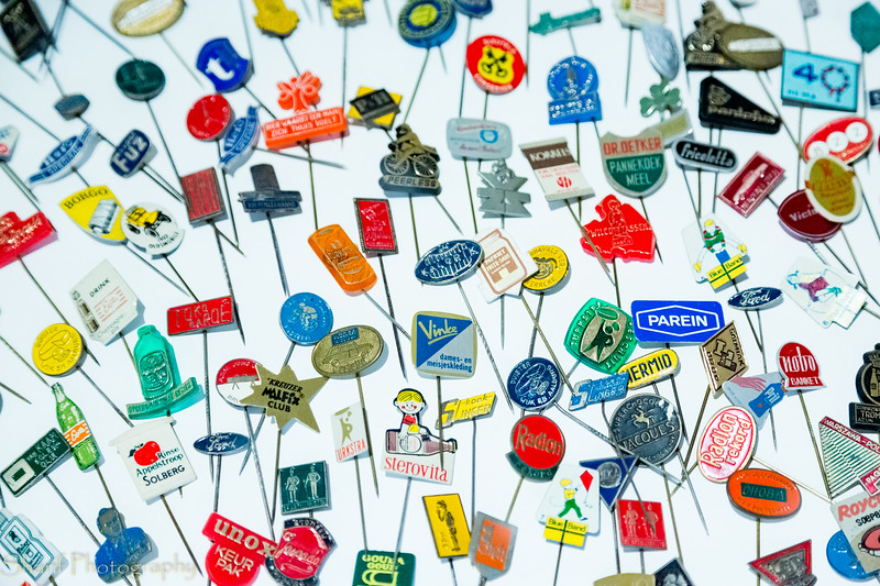 Pins used to advertise products in the sixties.