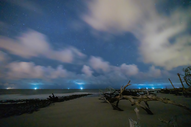 Starry Night with Low Flying Clouds over Driftwood