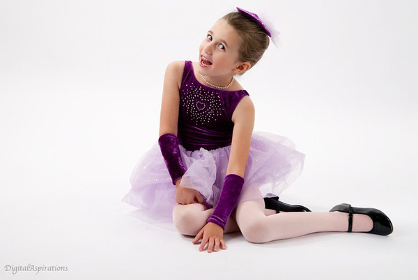 """The dancer!<br /> Will be sharing a few photos from yesterday's """"granddaughter"""" shoot. 2 strip-lights on the white paper background. Large softbox front left, 72"""" reflector to the right."""
