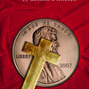 Today's photo is a CD cover I made for my brother. It is a Photoshop composite using photos of a velvet cloth and penny I captured and a cross I created from scratch in Photoshop.