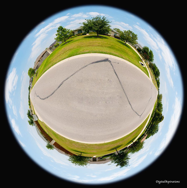 The Home Planet (Winding Way)<br /> Step one capture 360 degrees worth of images while standing in the middle of the road.<br /> Step two stitch them into one large rectangular panorama.<br /> Step 3, use Photoshop to map the pixels to Polar coordinates.