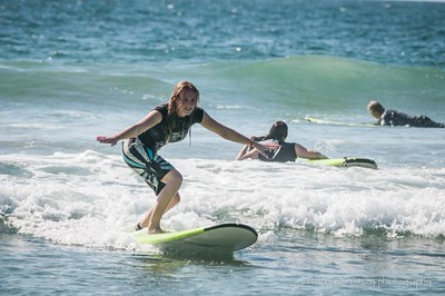 Carly taking surf lesson number 1 - looking good!