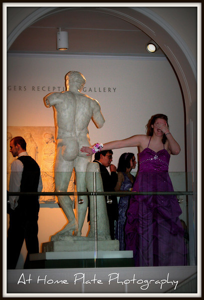April 30, 2011<br /> Saturday, 10:01pm<br /> <br /> Senior Prom at the Portland Art Museum - what a fun evening - could not resist having a bit of fun with the naked statues that outline the ball room.  I had to dare Nikki to go lay her hand on his bottom...and this is how she did it.  Made me laugh<br /> <br /> f/4, 1/60, 90mm, ISO 1600