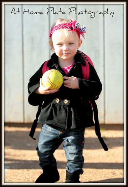 May 3, 2011<br /> Tuesday, 5:58pm<br /> <br /> Lil Miss - already picking up the softball....maybe gonna follow in her mama's footsteps <br /> <br /> f/2.8, 1/800, 73mm, ISO 200