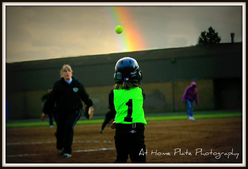 June 2, 2011<br /> Thursday,  7:48pm<br /> <br /> Hot Shots vs The Owls 8U game<br /> <br /> Hitting some where ...over the rainbow!<br /> <br /> f2.8, 70mm, 1/640,  ISO 400