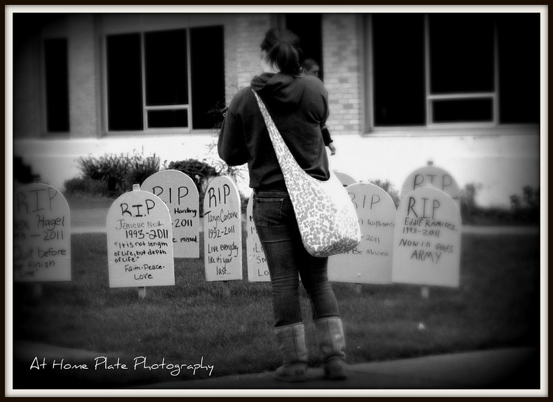 """April 27, 2011<br /> Wednesday, 11:01am<br /> <br /> Every 15 Minutes<br /> <br /> Taylor stands in front of her sisters tomb stone  as I pick her up from school. This is all part of the program """"Every 15 Minutes"""". For those of you that don't know what this is and may think this photo is pretty morbid - it's to get your attention and mainly the students attention. It...'s prom week at Gresham High. Today pre-selected students are """"killed"""" every 15 minutes when the Grim Reaper enters their classroom and takes them away. The dead students put on black robes and white face paint and then travel the halls and classrooms as silent reminders that people are killed by drunken drivers every day...every 15 minutes. These selected students are cut off from their family and friends until the next day when they return to school for a Senior class assembly. When we said """"goodbye"""" to Taryn this morning we knew that we would not be able to talk to her until the next day. Even knowing it's a dramatization - it's still very emotional. As I left the school today - in the show case was my daughter's Rugby sweat shirt with her name and time of death. I teared up at that point..then I walked out the door and there was her tomb stone - something no parent wants to see their child's name on. Tonight a dear friend, whose son is also one the pre-selected will be visited by police officers and will see what it's like when the authorities come and tell you your child has been killed by a drunk driver. They will bring some of his belongings and a story of the crash. Any student or parent involved in this program knows..it's no joke - it's to get everyone's attention. This is why I said having the officer pulling over a drunk driver in front of our home on Monday was so ironic. I know tomorrow will be tough and very emotional - but if it saves just one persons life - it's worth it. I pray this impacts all that are involved and makes them stop and think before they doing something that can chang"""