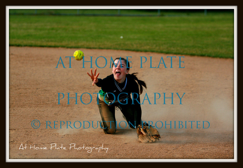 """June 24, 2011<br /> Friday, 7:01pm<br /> <br /> """"Rommie"""" dives for a line drive - stops it and tosses the ball to first getting the runner out.<br /> <br /> f/2.8, ISO 400, 110mm, 1/2500"""
