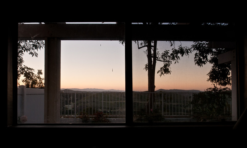March 10, 2013 -- Morning through the windows at chez McLennan.  As part of an online film class I've been taking,we watched <b>Punch-Drunk Love</b> to see how the director, Paul Thomas. Anderson, used color and framing to help tell the story. He did a lot of framing with horizontal and vertical lines, which inspired this attempt to use the vertical and horizontal lines around my house to see what happened. He also uses color motifs of red, blue, green, and white, plus lens flare -- I didn't try to emulate those...yet. (Actually, the color motifs are far more obvious than the framing. It is probably one of the better Adam Sandler movies too.)