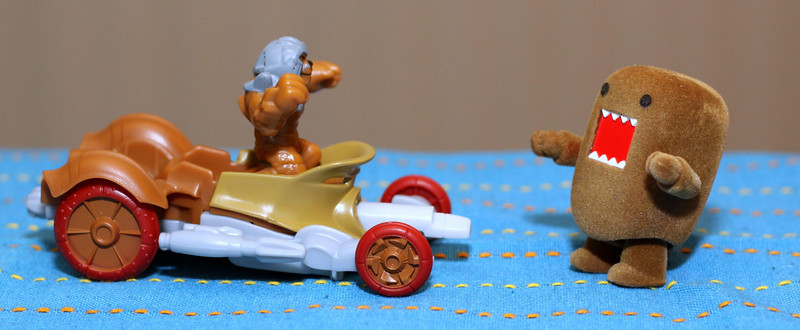 Day 114- Little Domo tries to take on Kalus and Fangore (2010.04.24)- This is the Hot Wheels battle force 5 car and character trying to knock over Domo...don't worry Domo won this battle. #365 Project