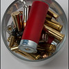 1/18/2011 - Shot glass<br /> <br /> Was in the basement putting some important documents in the gun safe and decided to organize some of my crap in there. Had some ammo out and decided to snap this pic. Don't know why I've been taking pics lately shooting into something...