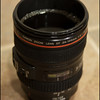 1/12/2011 - Late night coffee<br /> <br /> Since caffeine does not really affect me (I can sleep within 10 minutes of drinking a can of Mt Dew), and I was craving coffee I thought I'd snap a pic of my 2nd 24-104 F4L lens that I modified to a coffee cup. :)