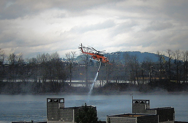 1227 water  This fire fighting helicopter slurps up water from a lake or river and then can spray it every which way.  Watching its exercise was pretty cool.