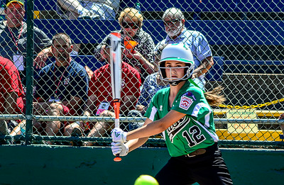 0807 I'm Outta Here  Little League Softball World Series started in town today featuring teams from around the world.  At first I was happy to see that this nasty foul line-drive was going to be too low to hit my  lens, I figured the rest of it out just in time to get out of the way.  Kids today should show more respect is what they should do. ;-)