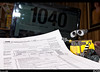 Well, it's that time of season again and Wall-e is looking over the 1040 tax form and wondering where to start first. This year I am having someone do my taxes with the business and college stuff, I'm already lost.