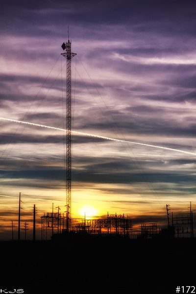 Power<br /> A power plant at sundown, I'm unsure about the vapor trail tho. I just love it when the sky is like this.