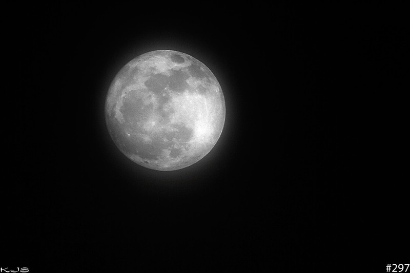 March Full Moon<br /> <br /> Tonight was the full moon and of course there was a light layer of fog/clouds in the air so it took some cleaning up to get a pic.